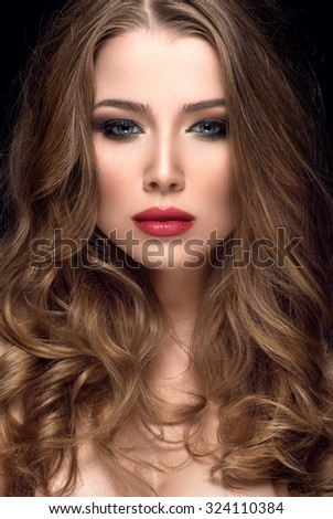 Beautiful woman with nice make up and red lips - stock photo
