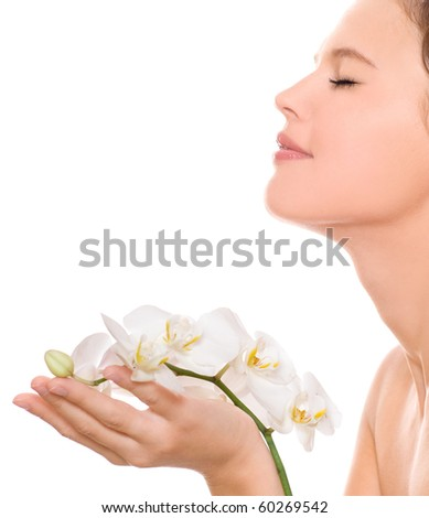 Beautiful woman with orchid flower, isolated on the white - stock photo