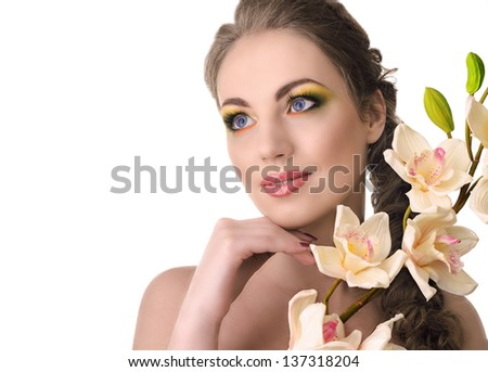 Beautiful woman with orchid in hair, isolated on white