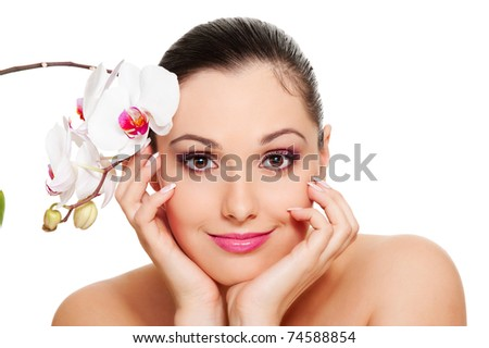 beautiful woman with orchid over white background