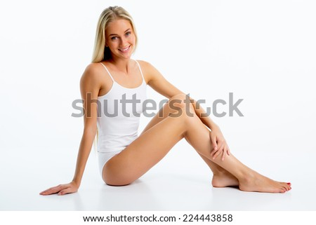 Beautiful woman with perfect figure in underwear - stock photo