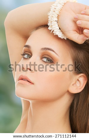 Beautiful woman with perfect make up and bracelet. - stock photo
