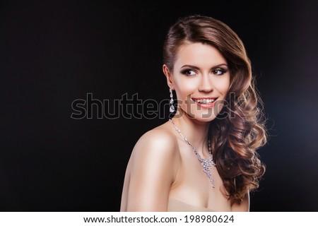 beautiful woman with perfect makeup wearing jewelry - stock photo
