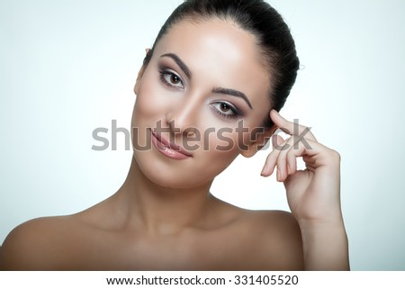 Beautiful woman with perfect skin and face - studio shot - stock photo