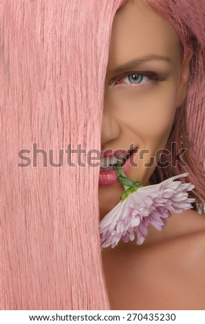 Beautiful woman with pink hair and flower in his teeth - stock photo