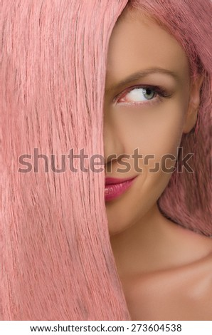 Beautiful woman with pink hair looking to side - stock photo