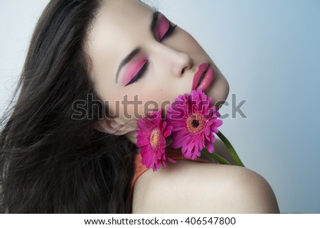 beautiful woman with pink makeup and flowers, studio shot