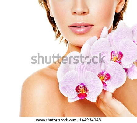 beautiful woman with pink orchid - stock photo