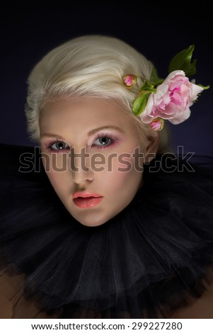 Beautiful woman with pink rose in hair - stock photo