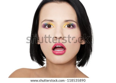 Beautiful woman with rainbow eye make up, isolated on white