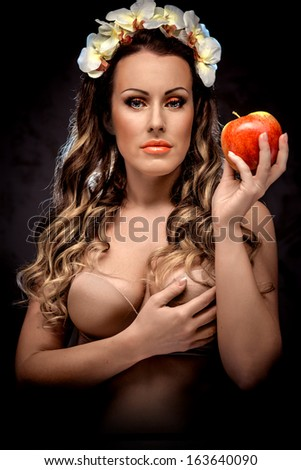 Beautiful woman with red apple, conceptual photo - stock photo
