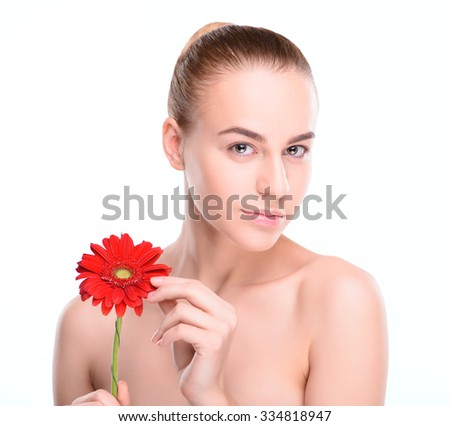 Beautiful woman with red gerbera. Isolated on white background.