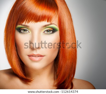 Beautiful Woman with Red Hair and bright makeup - stock photo