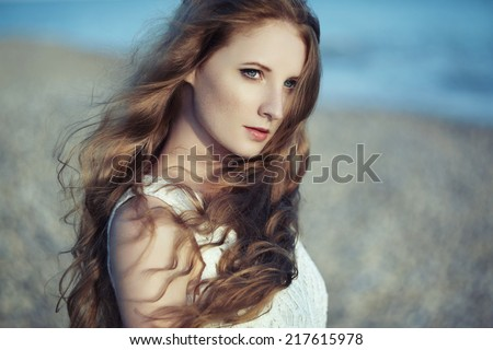 Beautiful woman with red hair at the sea. Fashiob photo - stock photo