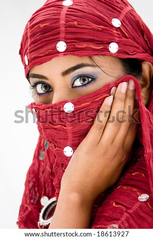 Beautiful woman with red head scarf, isolated - stock photo