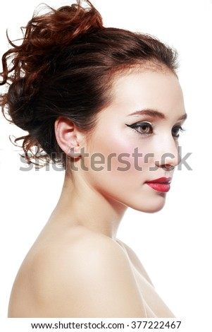 Beautiful woman with red lips and chic glamour make-up close up