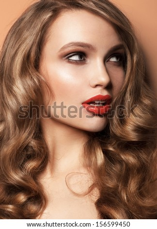beautiful woman with red lips studio shot Color background, curly hair - stock photo