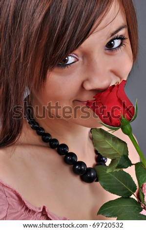 Beautiful woman with red rose isolated on white - stock photo