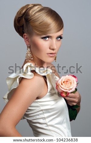 Beautiful woman with rose. Fashion photo - stock photo