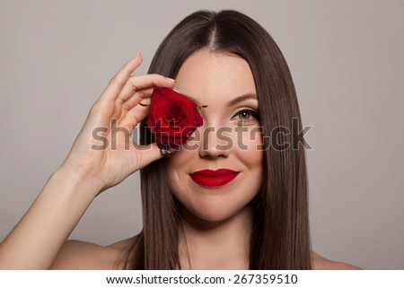 Beautiful woman with rose flower - stock photo
