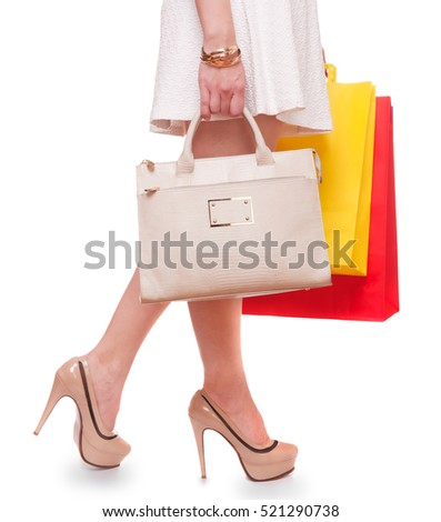 Beautiful woman with shopping bags dress, and high heels, closeup isolated on white background,