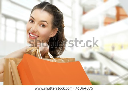 Beautiful woman with shopping bags in hands - stock photo