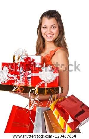 Beautiful woman with shopping bags. Isolated - stock photo