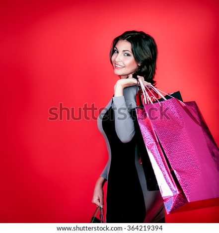 Beautiful woman with shopping bags isolated - stock photo
