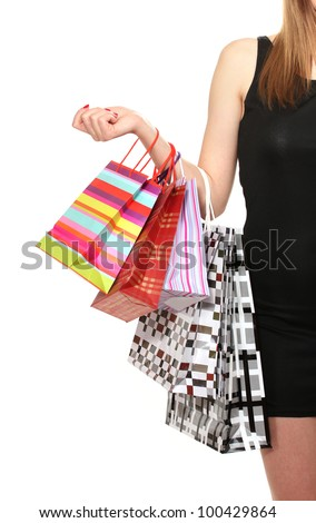 beautiful woman with shopping bags isolated on white - stock photo