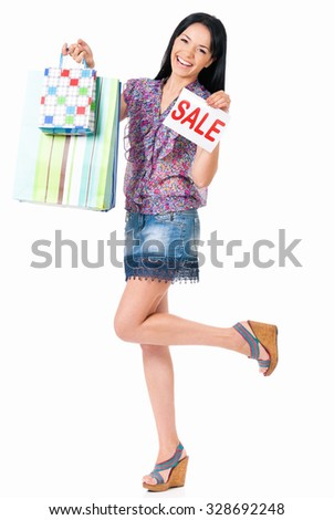 Beautiful woman with shopping bags, isolated on white background  - stock photo