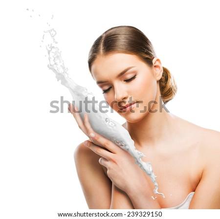 Beautiful woman with skin cream splash - stock photo