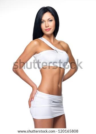 Beautiful woman with sporty slim body - studio shot - stock photo