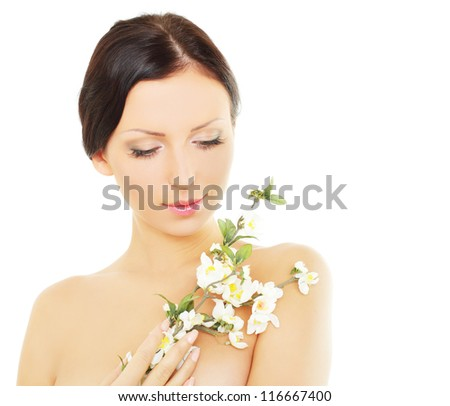 Beautiful woman with spring blossom, spa concept - stock photo