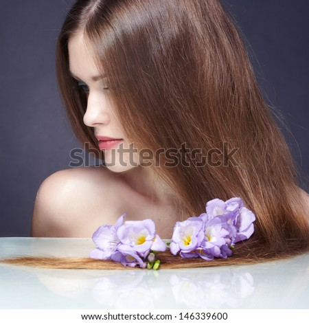 Beautiful Woman with Straight Long Hair. On black background - stock photo