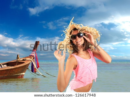 Beautiful woman with straw hat on the beach. Thailand. - stock photo