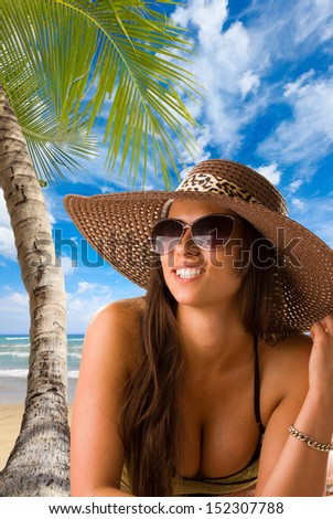 Beautiful woman with straw hat on the tropical beach. Thailand.