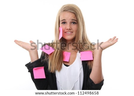 Beautiful woman with stress and post it papers - stock photo