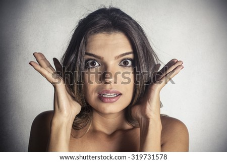 Beautiful woman with stressed expression - stock photo