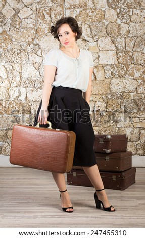 Beautiful woman with suitcases ready for trip - stock photo