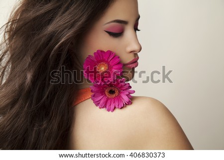 beautiful woman with summer makeup and flowers, studio shot