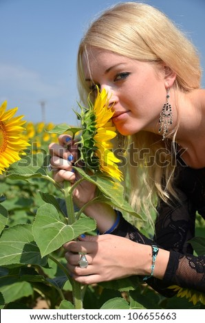 Beautiful woman with sunflowers