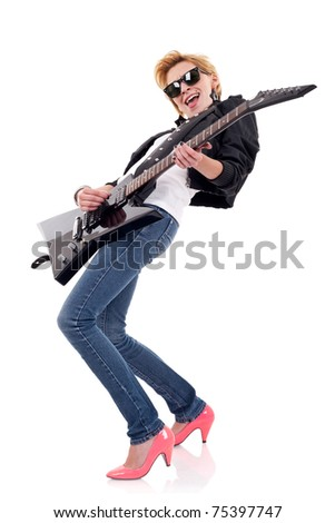 beautiful woman with sunglasses playing an electric guitar - stock photo