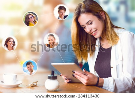 Beautiful woman with tablet, communication and connection concept - stock photo