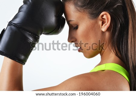 beautiful woman with the black boxing gloves, studio shot