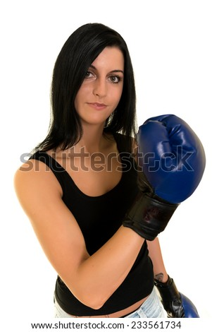 beautiful woman with the blue boxing gloves, studio shot  - stock photo