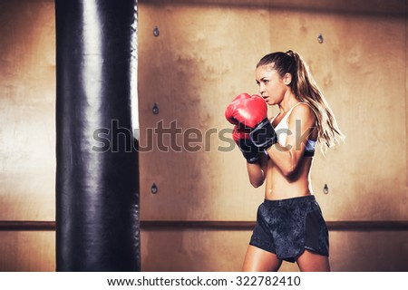 Beautiful Woman with the Red Boxing Gloves. Attractive Female Boxer Training. - stock photo