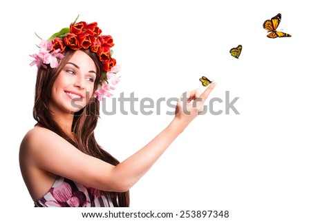 beautiful woman with tulip hair decoration and butterflies - stock photo