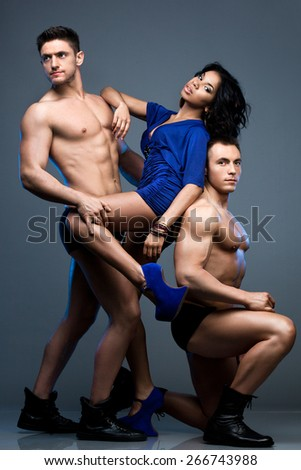 beautiful woman with two guys - stock photo