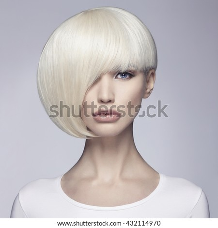 Beautiful woman with unusual bob hairstyle.beauty salon fashion blonde model girl.hair concept