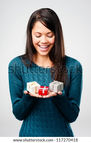 Beautiful woman with valentines day gift box present surprise isolated on grey background - stock photo